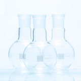 Set of three empty spherical flat bottomed temperature resistant flasks Stock Photo