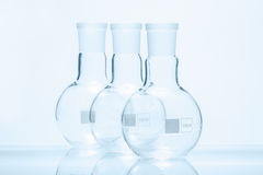 Set of three empty spherical flat bottomed temperature resistant flasks Royalty Free Stock Photos