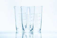 Set of three empty temperature resistant conical beakers for measurements Royalty Free Stock Photos