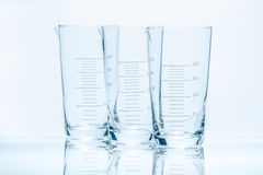 Set of three empty temperature resistant conical beakers for measurements Stock Photos