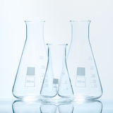 Set of three empty temperature resistant conical flasks for measurements stock photo