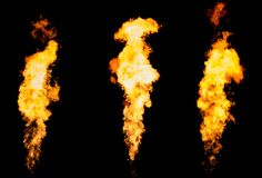 Set of three isolated fire pillars. Flame tongue goes from gas burner. Royalty Free Stock Images
