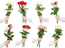 Set of three and five rose flower bouquets in hand Royalty Free Stock Images