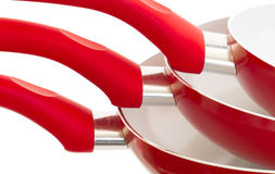Set of three frying pans, red Stock Photo