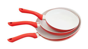 Set of three frying pans, red Stock Photography