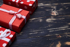 A set of three gift boxes isolated over shabby flat layout Royalty Free Stock Photos