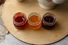 Set of three glass jam jars Stock Image