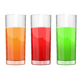 Set of three glasses of juice. Red, green and orange Royalty Free Stock Photography
