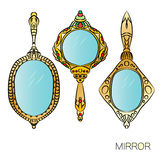 Set of three gold vintage Hand Mirror. Royalty Free Stock Photography