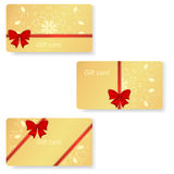 Set of three gold VIP gift cards with red ribbons and bows. Royalty Free Stock Image