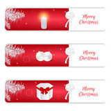 Set of three horizontal Christmas banner, red and white color, gift box, balls, burning candle and white spruce branch. For web de Stock Image