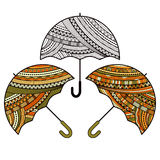 Set of three icons of umbrella with ethnic ornament Stock Images