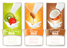 Set of three labels of fruit and berries in milk splashes. Royalty Free Stock Photos