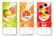 Set of three labels of of fruit in milk splashes. Stock Images
