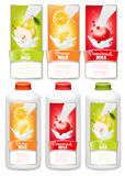 Set of three labels of of fruit in milk splashes. Stock Photo