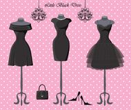 Set of  three little black dresses. The composition of the three female's little black dresses,handbag and high-heeled shoes.Polka dot  background. Fashion Stock Photography