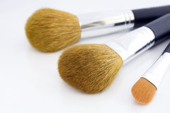 Set of three makeup brushes. For face powder, concealer and eye shadow, on white background Royalty Free Stock Images