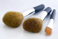 Set of three makeup brushes. For face powder, concealer and eye shadow, on white background Stock Photo
