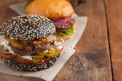 Set of three mini homemade Burger with marble beef and vegetables on a old wooden background. the concept of junk food and fast fo. Od. with copy space Stock Image