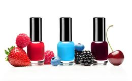 Set of three nail polishes with different summer berries. On white background. Blueberry, raspberry, strawberry, cherry, blackberry. Beauty concept Stock Photo
