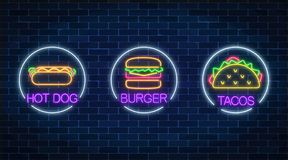 Set of three neon glowing signs of burger, hot dog and tacos in circle frames on a dark brick wall background. vector illustration