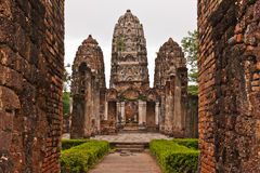 Set of three pagodas behind wall in sukhothai Stock Photography