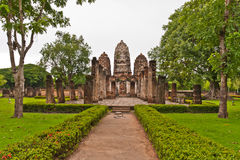 Set of three pagodas in sukhothai and walkway. Set of three pagodas and walkway in sukhothai historic park Thailand Royalty Free Stock Photography