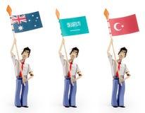 Set of paper men holding flags. Set of three paper men lifting flags. Australian flag, Saudi arabia flag, turkey flag Royalty Free Stock Photography