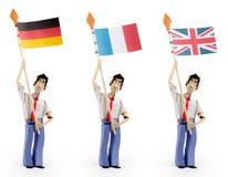 Set of paper men holding european flags. Set of three paper men lifting flags. Germany flag, France flag, UK flag Stock Image