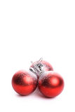 Set of three red christmas balls with reflex Royalty Free Stock Photo
