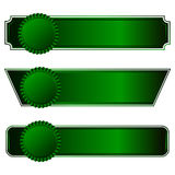 A set of three rosette with horizontal ribbons of green. On a dark background Stock Photography