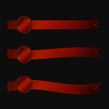 A set of three rosette with horizontal ribbons of red. On a dark background Royalty Free Stock Photo