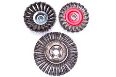 Set of three rotating metal brushes Stock Images