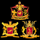 A set of three royal or chivalrous arms on a black background Royalty Free Stock Photos