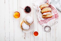 Tea time with festive sufganiyot donuts Stock Images