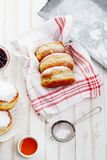 Tea time with festive sufganiyot donuts filled with jelly Royalty Free Stock Photos