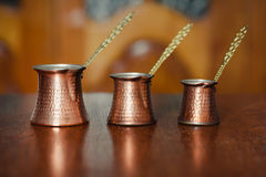 Set of three turkish coffee pot Royalty Free Stock Photos