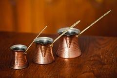 Set of three turkish coffee pot. Set of three bronze turkish coffee pot Stock Photos
