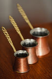 Set of three turkish coffee pot. Set of three bronze turkish coffee pot Stock Image