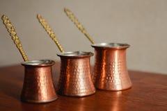 Set of three turkish coffee pot. Set of three bronze turkish coffee pot Stock Photography
