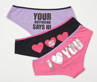 Set of three underwear for women on the white background Royalty Free Stock Image