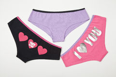 Set of three underwear for women on the white background Stock Image