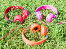 Set of three varicolored colorful headphones Royalty Free Stock Images