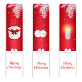 Set of three vertical Christmas banner, red and white color, gift box, balls, burning candle and white spruce branch. For web desi Royalty Free Stock Images