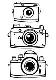 Set of three vintage film photo cameras isolated o Stock Images