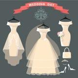 Set of three wedding dresses.Bridal shover. The composition of the three female's wedding dresses,Bridal veil,bouquet,handbags and high-heeled shoes. Bridal Royalty Free Stock Photography