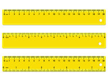 Set of three yellow rulers. Marked in centimeters, inches and combined, rectangular shape. Graduation of inches ruler of 1/16 Stock Image
