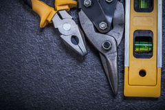 Set of tin snips pliers construction level on Royalty Free Stock Photography