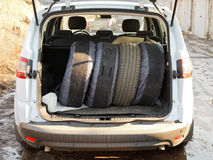 Set of tires in trunk of car Stock Photos