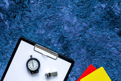 Set to judge competition. Yellow and red cards, stopwatch, whistle, pad on blue table background top view copyspace Royalty Free Stock Photos